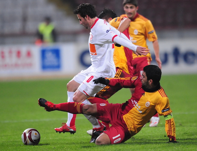 Arda Turan (R) of Galatasaray vies for t
