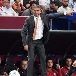 Galatasaray's coach Hamza Hamzaoglu gestures during the Champions League group C football match Galatasaray vs Atletico Madrid on September 15, 2015 at the TT Arena Stadium in Istanbul. AFP PHOTO / OZAN KOSE        (Photo credit should read OZAN KOSE/AFP/Getty Images)